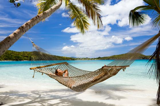 woman lying in hammock at the Caribbean beach