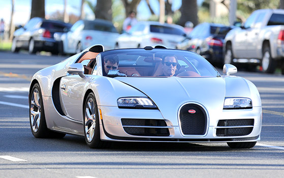 *EXCLUSIVE* Arnold Schwarzenegger meets with friends in his Bugatti Veyron