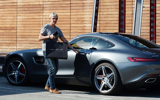 Comedienne Ellen Degeneres is spotted heading to her souped up McClaren Mercedes Benz after shopping at Maxfields Clothing store in West Hollywood, Ca